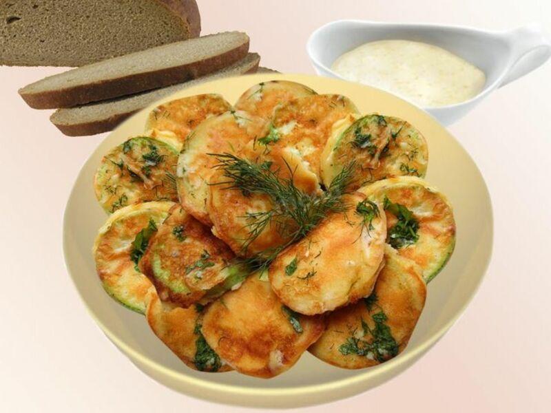 Закуска из кабачков в яичном кляре с зеленью и чесноком